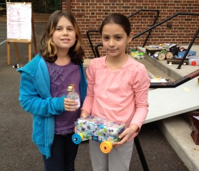 Fourth graders turn knowledge of machines and motion into recycled racers