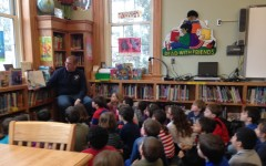 Fireman Benkwitt visits Colonial to read 'Horton Hears a Who' to second grade