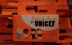 Colonial students carry orange boxes to Trick or Treat for UNICEF and help others