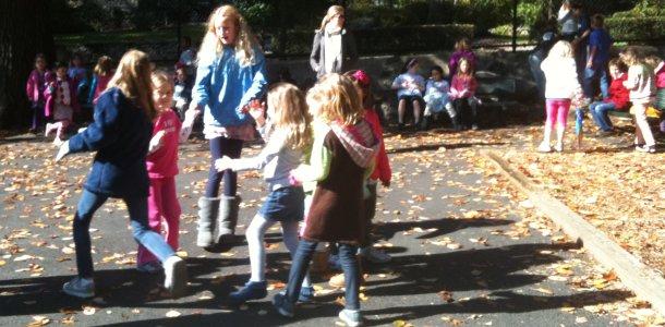 Fifth graders buddy with kindergartners, teach kick ball, friendship