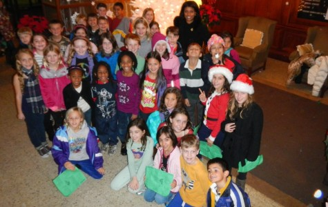 Colonial fourth grade carolers with Mrs. Wilson at Sound Shore Medical Center.