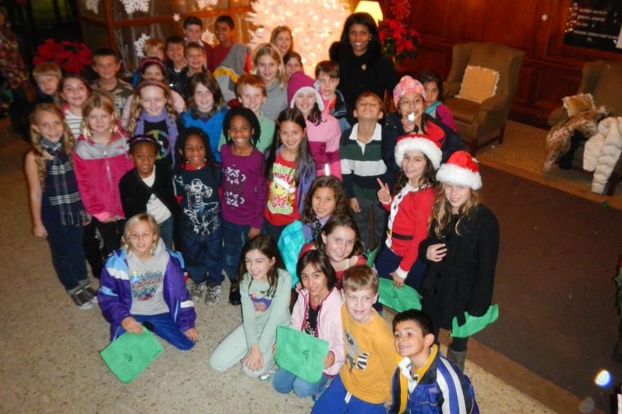 Colonial+fourth+grade+carolers+with+Mrs.+Wilson+at+Sound+Shore+Medical+Center.