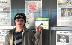 Sam Rodd visited the Newseum and took a page of the Colonial Times so it could join the wall of newspapers.