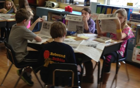 Extra! Extra! Newsies pass out print edition of Colonial Times to students and parents