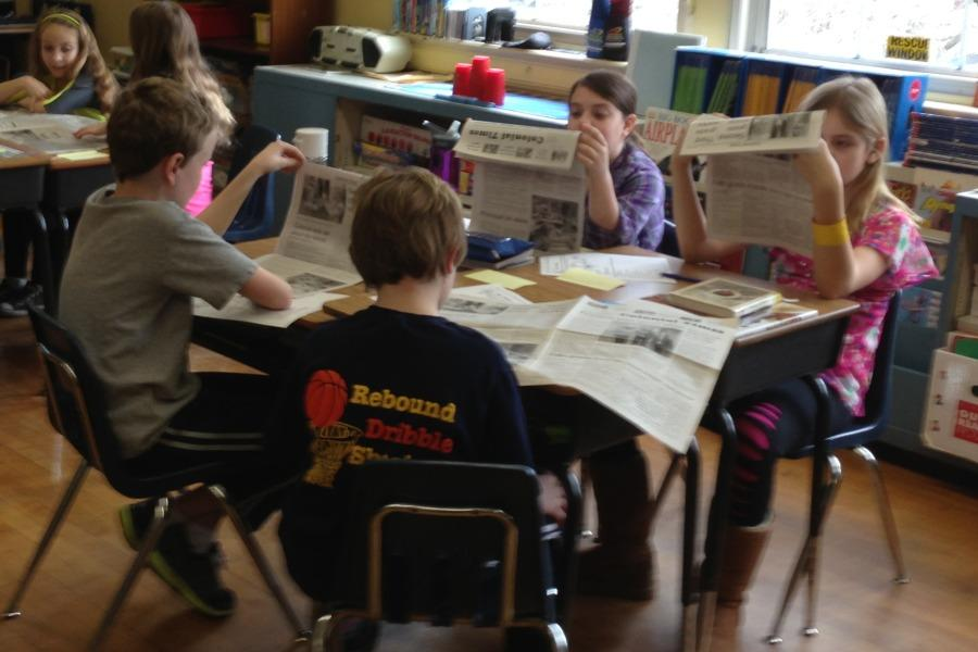 Students in Mr. Ron Martucci's class read the print edition of the Colonial Times.