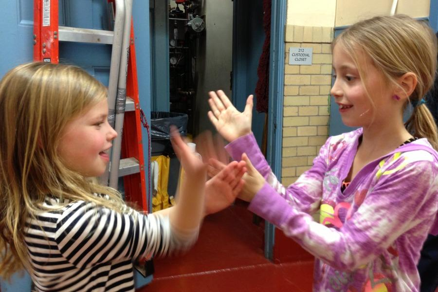 Hand games played by Kate Girolamo (left) and Olivia Orlando.