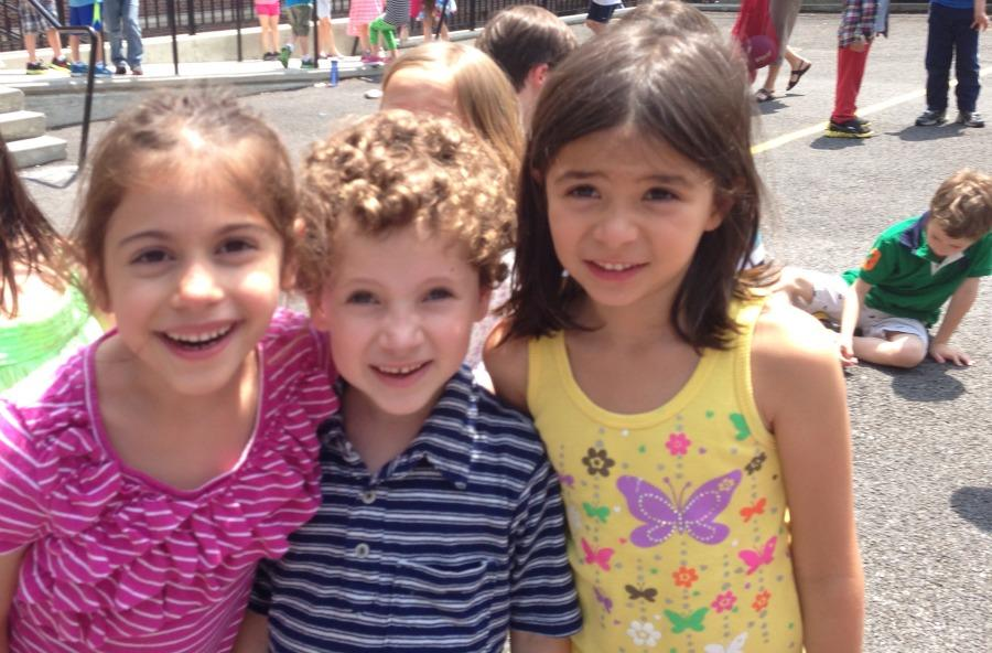 The K-5 buddy program has been around a long time. From left, then Kindergartners Kira Findikyan, Liam Ginsburg and Waverly Nanda on the playground where they learned from their buddies (four years ago).