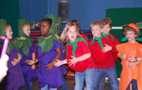 Vegetables sing and dance in year-end Kindergarten show (from June print newspaper)