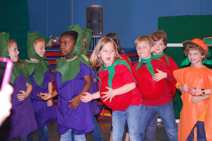 Kindergartners danced as vegetables in the year-end show.