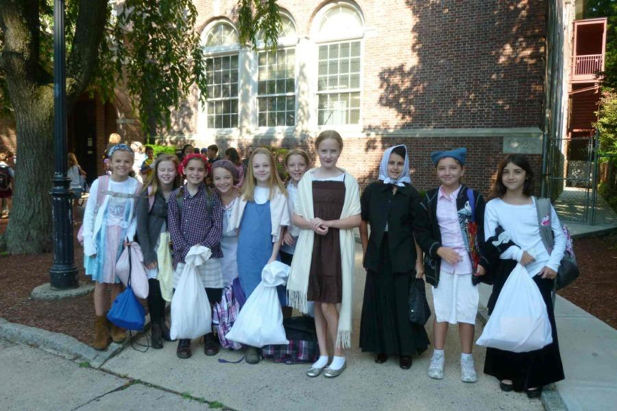 Fourth graders from two years ago dressed as immigrants for that year's Immigration Simulation.