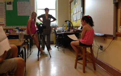 Grayce Cooper (left) filmed Bridget Petti (right) for a memory movie. Picture House teacher Stephanie Schleicher looked on.