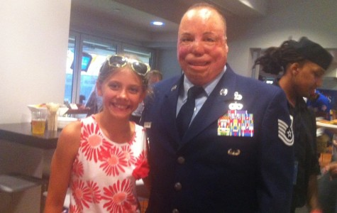 Air Force veteran Israel Del Toro, pictured with news editor Charlotte Howard, was honored with 29 other vets at the MLB All-Star Game.
