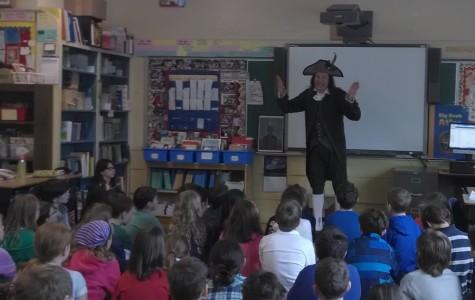 Jonathan Kruk tells fourth graders interesting stories about American history