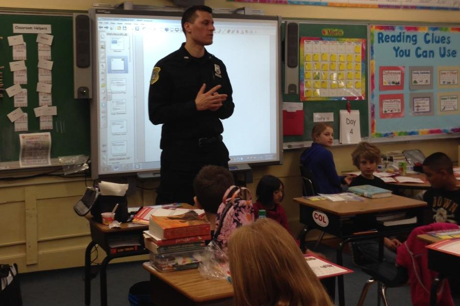 Pelham Police Officer Brian Hendrie taught the DARE class to Ms. Diana Spadaro's students.