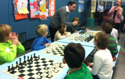 Fifty kids attend family chess night to challenge Mr. E and learn how to play