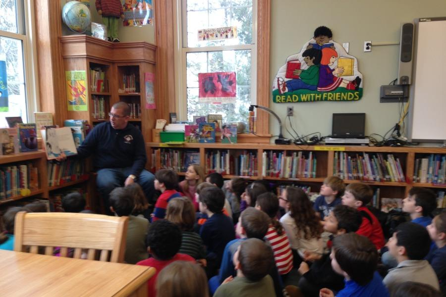 Firefighter Frank Benkwitt read to the second grade on Read Across America Day.