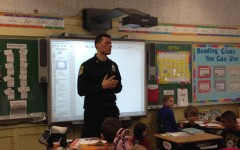 Pelham Police Sergeant Hendrie starts DARE classes to teach fifth graders to resist drugs
