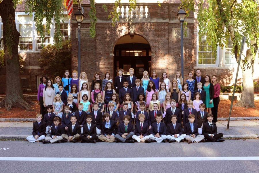 The class of 2014 posed with their teachers in front of the school doors most entered six years ago.