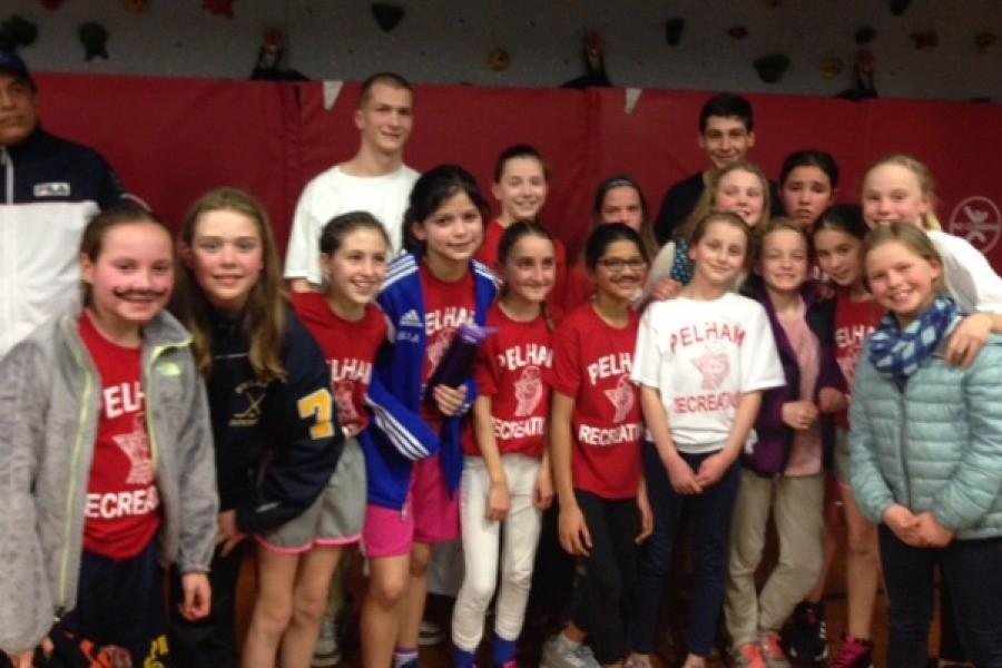 The Colonial Red rec basketball team joined with friends, supporters and coaches after the championship game.