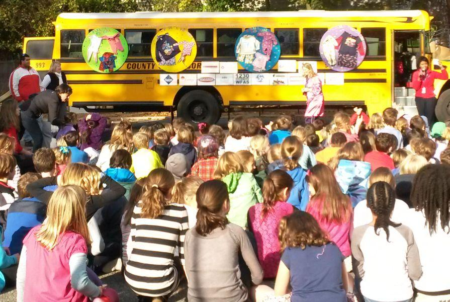 Colonial Stuffs Bus to Donate Pajamas and Books to Children in Need