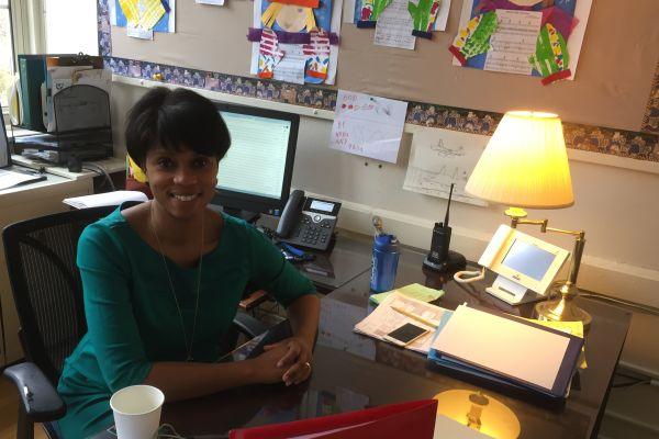 Mrs. Wilson in her office.