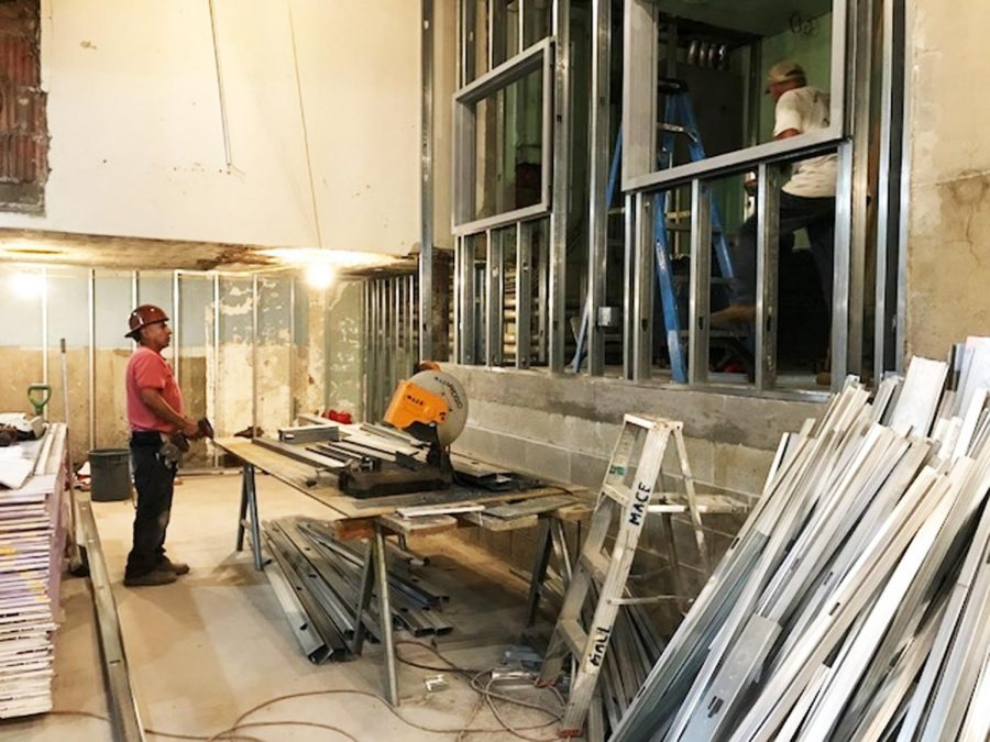Construction workers complete demolition of new locker rooms.