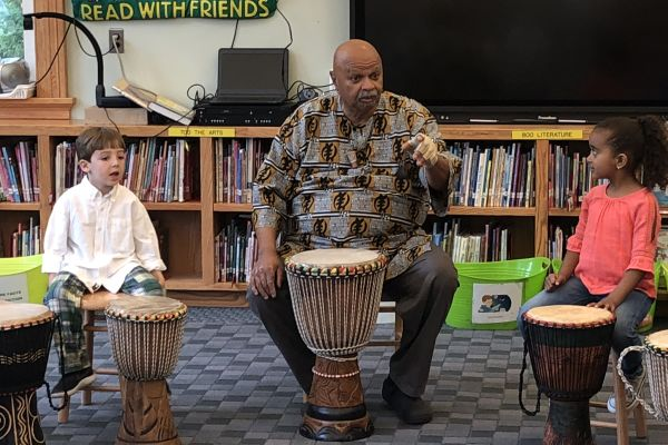 Kindergarten students learned African drumming with John Grady.