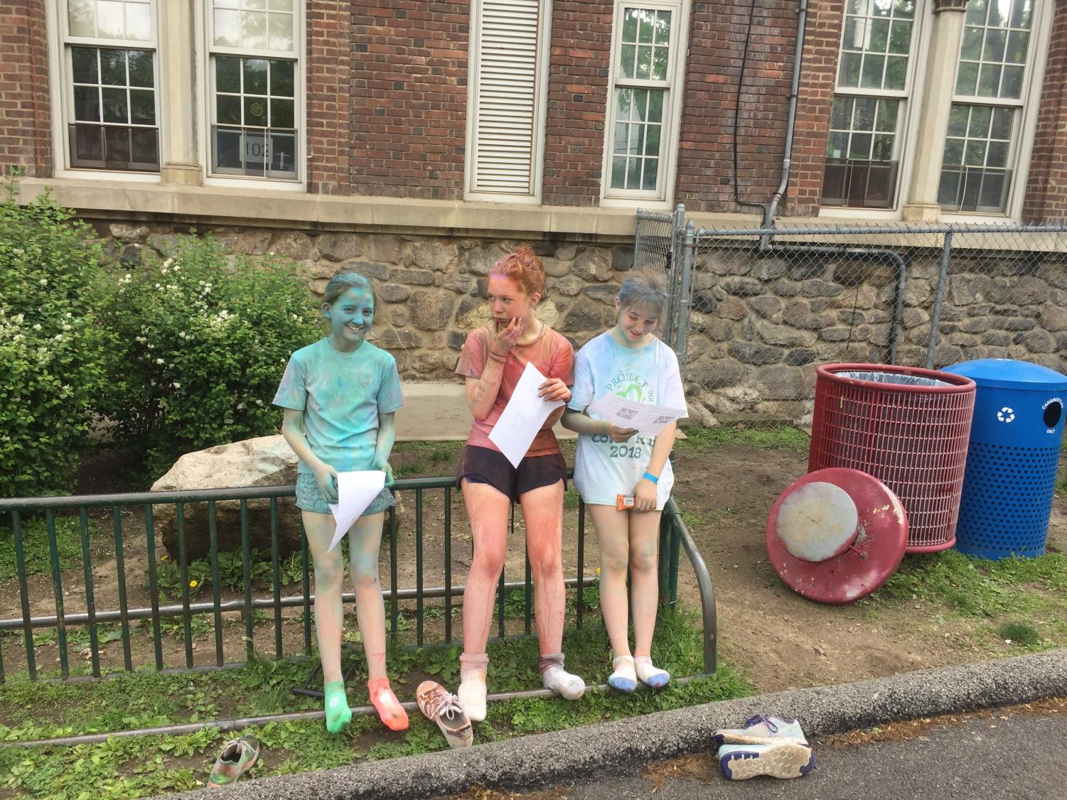 Three runners were left decorated with the run's rainbow corn starch.
