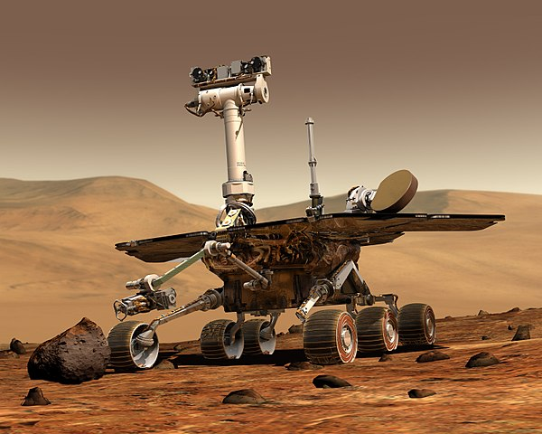 An artists concept portrays a NASA Mars Exploration Rover on the surface of Mars.